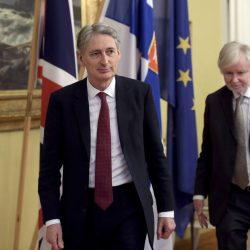 British Foreign Secretary Philip Hammond (L) walks during a meeting with Finnish Foreign Minister Erkki Tuomioja (R) in Helsinki, January 8, 2015. REUTERS/Markku Ulander/Lehtikuva (FINLAND - Tags: POLITICS) ATTENTION EDITORS - THIS IMAGE HAS BEEN SUPPLIED BY A THIRD PARTY. IT IS DISTRIBUTED, EXACTLY AS RECEIVED BY REUTERS, AS A SERVICE TO CLIENTS. NO THIRD PARTY SALES. NOT FOR USE BY REUTERS THIRD PARTY DISTRIBUTORS. FINLAND OUT. NO COMMERCIAL OR EDITORIAL SALES IN FINLAND